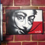Salvador Dali poster over illegal advertising posters